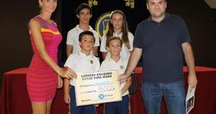 Representantes de la comunidad educativa de Alminar y de Unicef