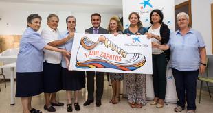 La Caixa aporta cerca de 1500 pares de zapatos a niños y adultos sin recursos